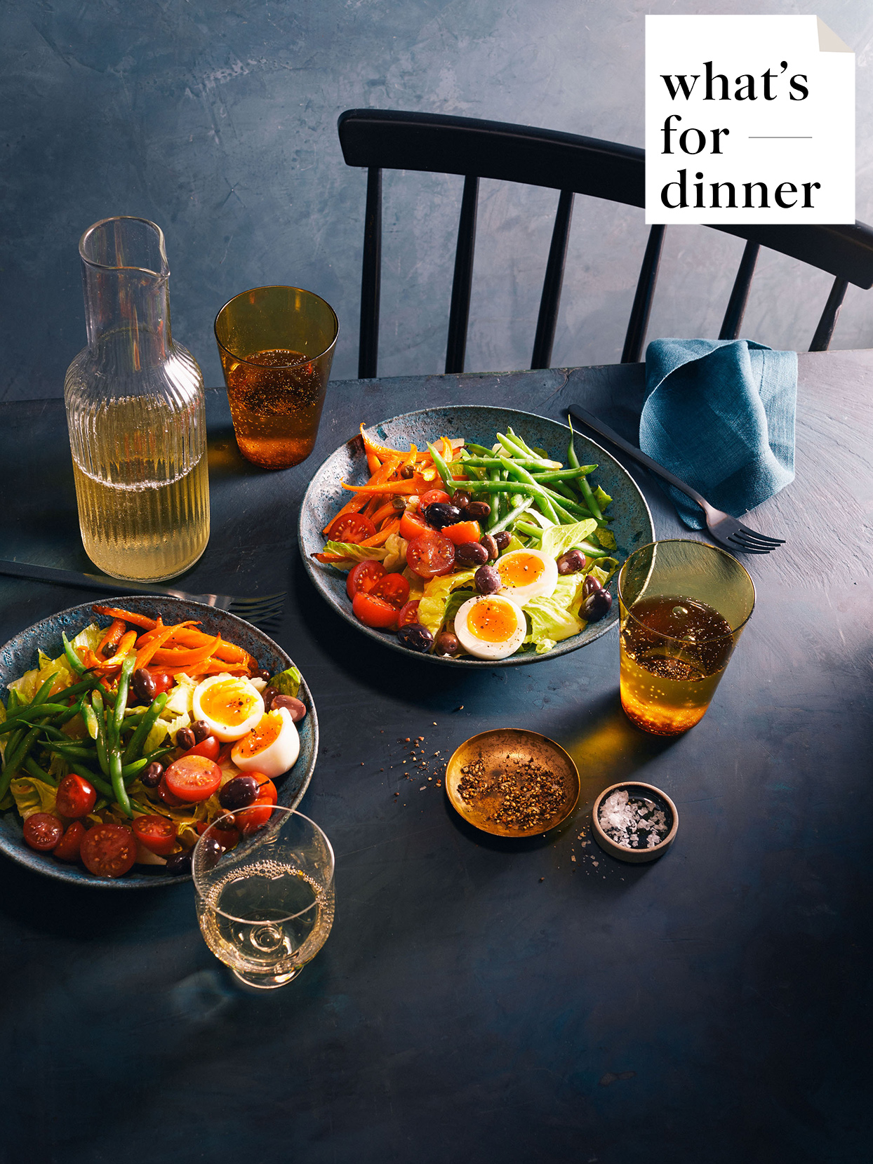 table with two plates of roasted carrot nicoise