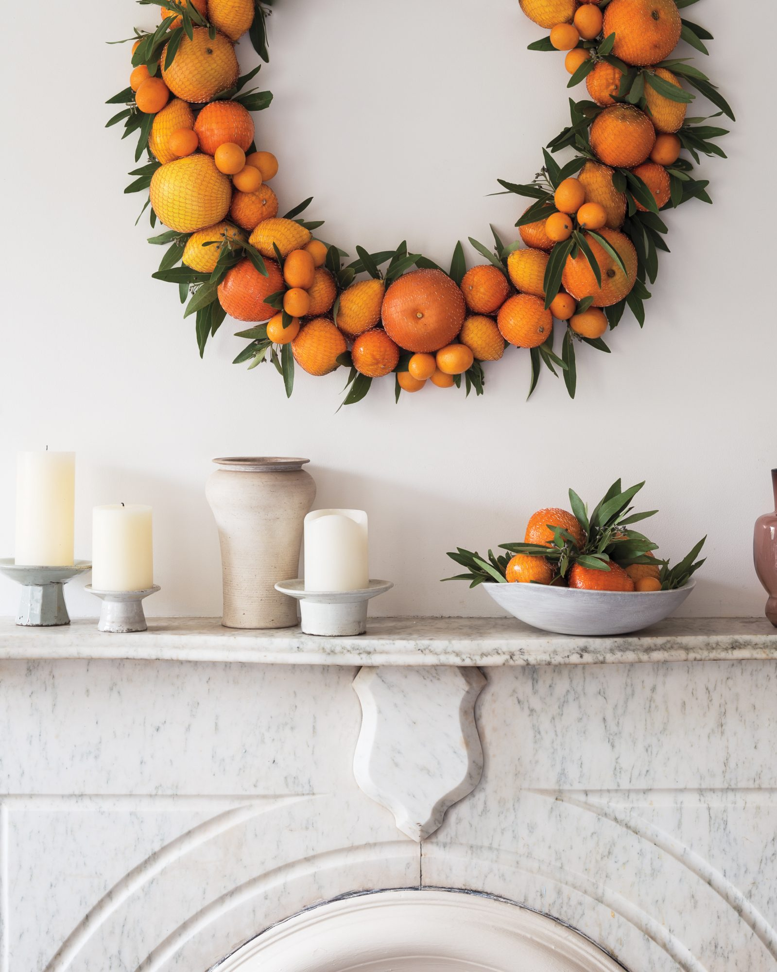 citrus wreath on a marble mantel