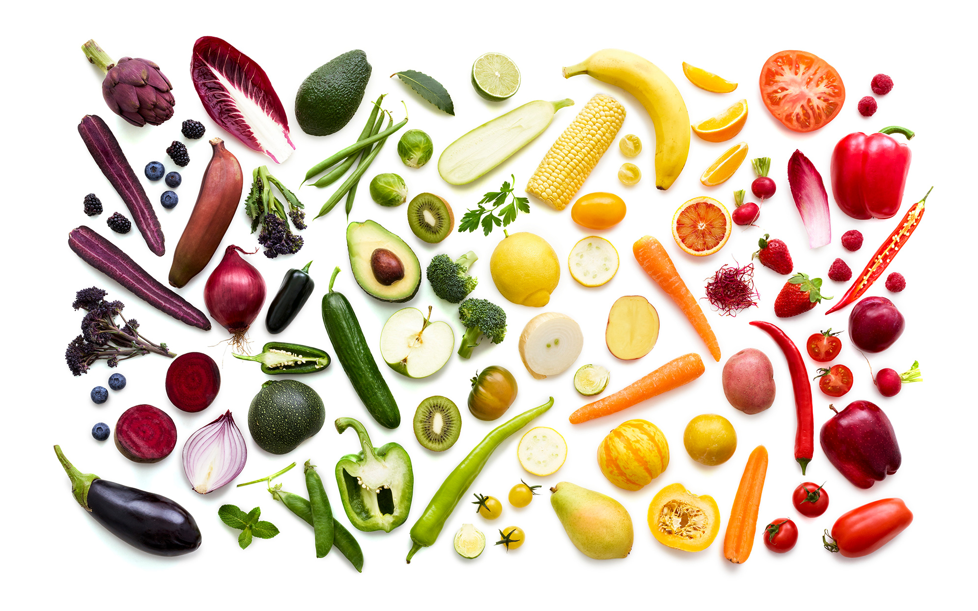 colorful vegetables against white background