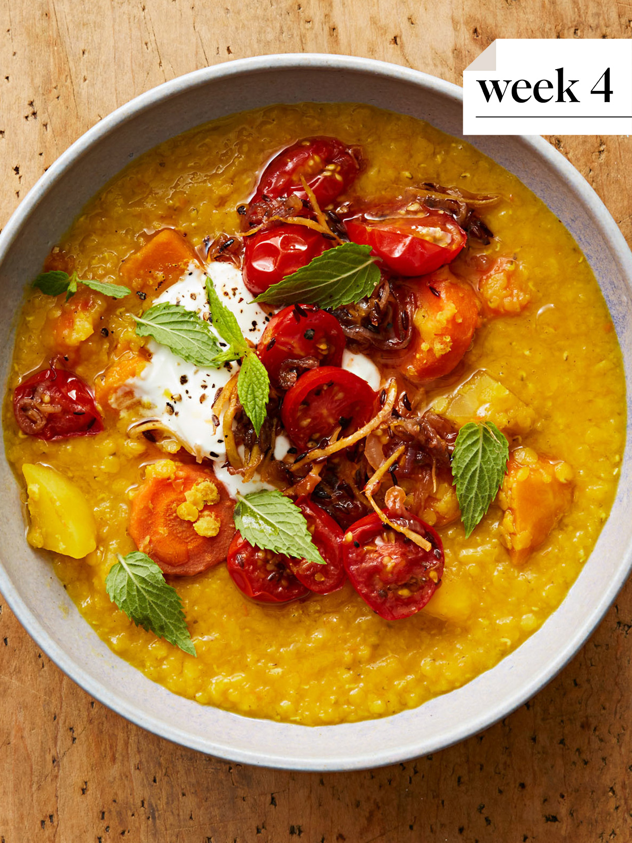 golden dal with gingered tomatoes atop wooden surface