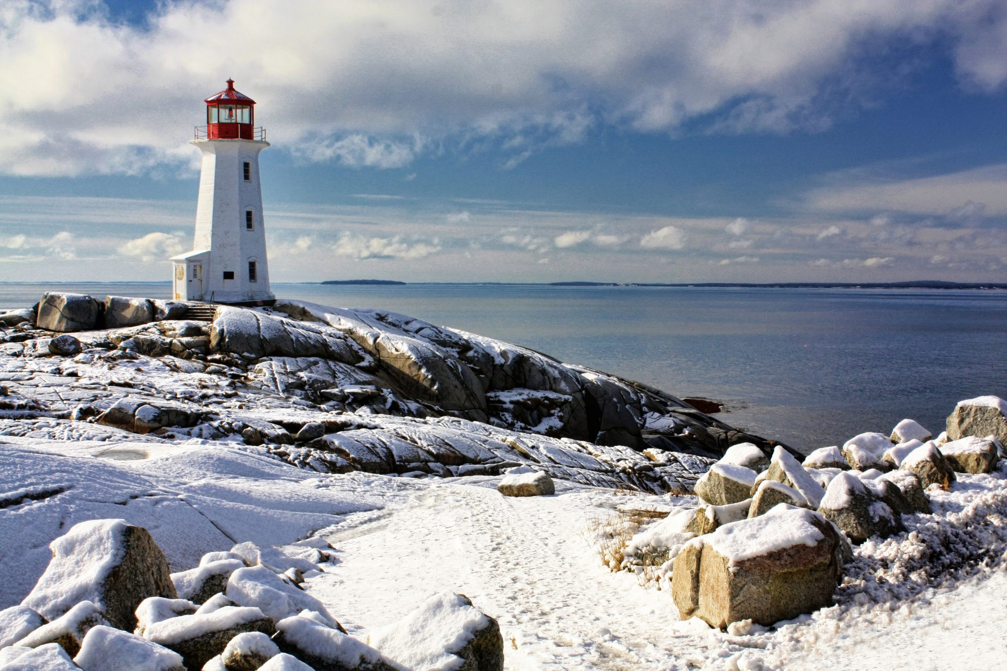 peggy's cove snowy lighthouse with water backdrop