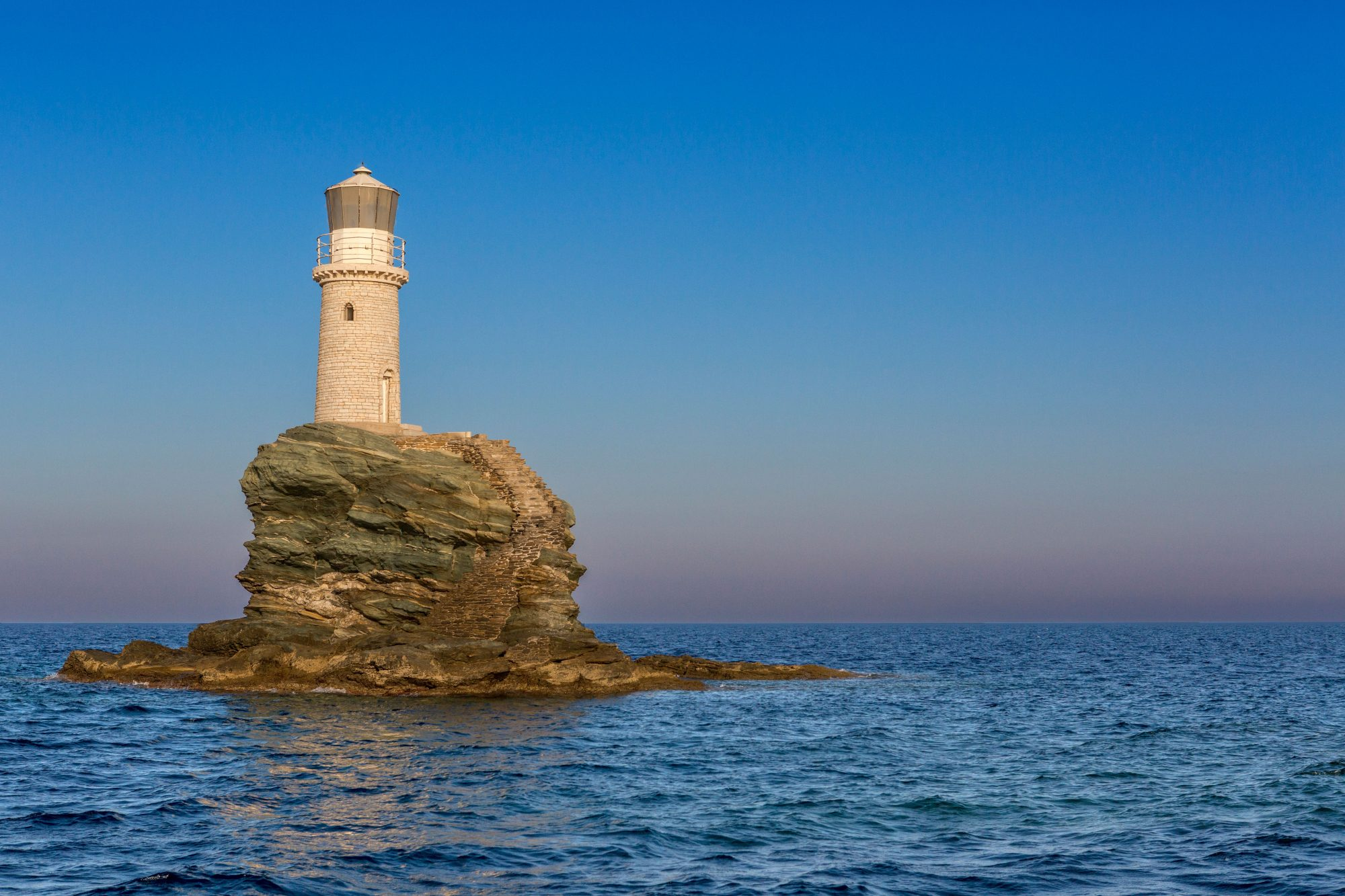 tourlitis lighthouse surrounded by water
