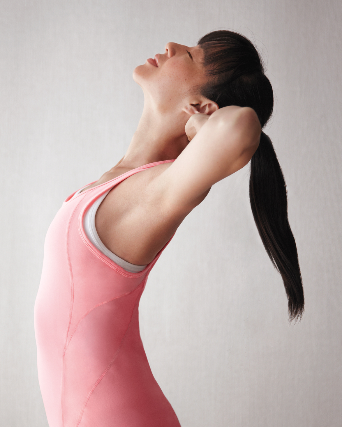 woman in pink stretching