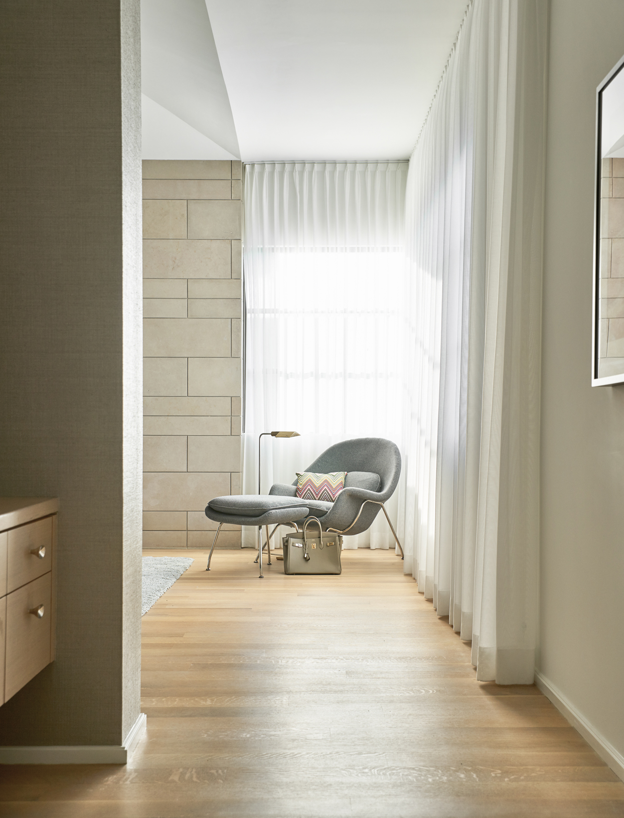 gray chair in corner with curtains