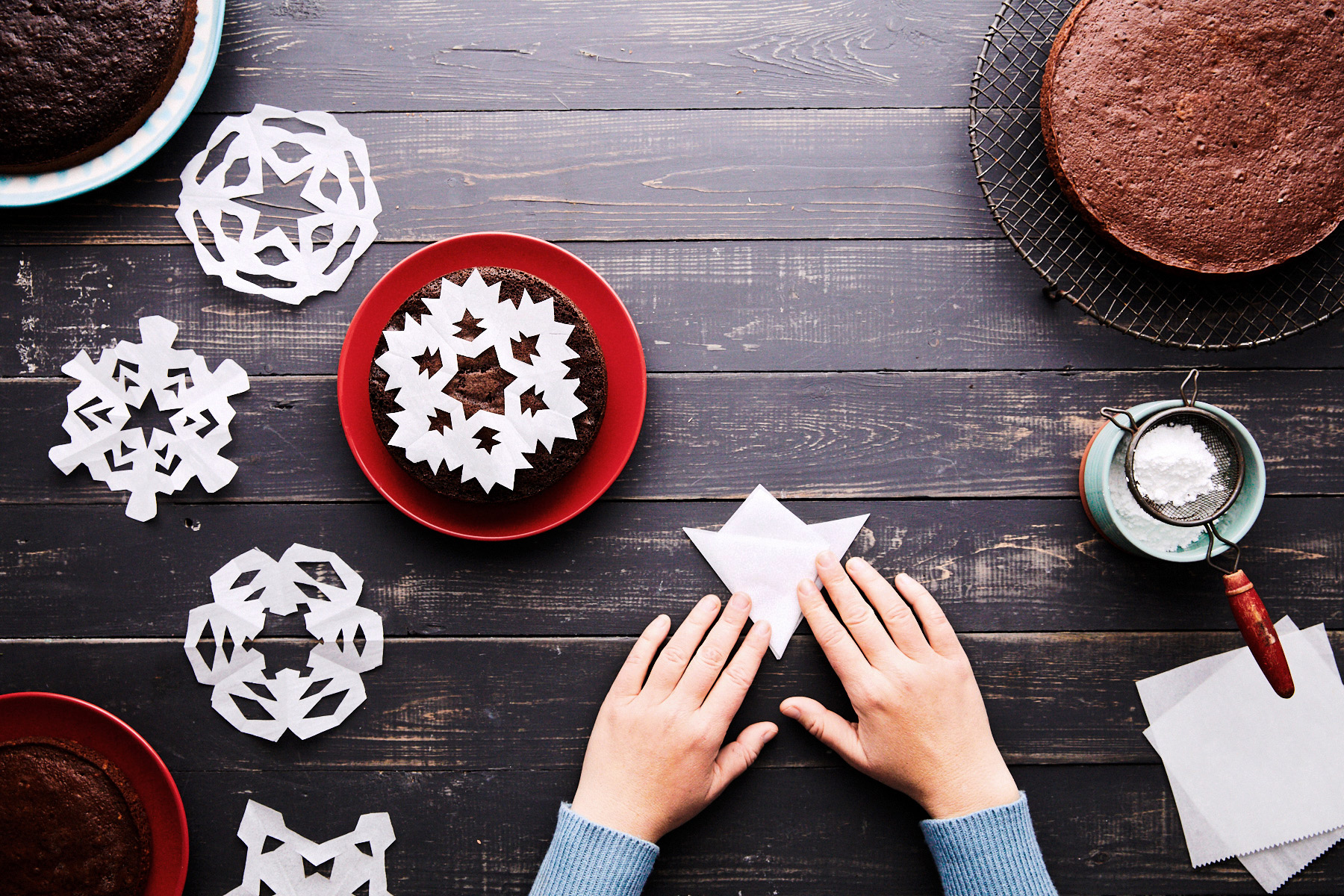 folded paper forming stencil snowflake cake decorating