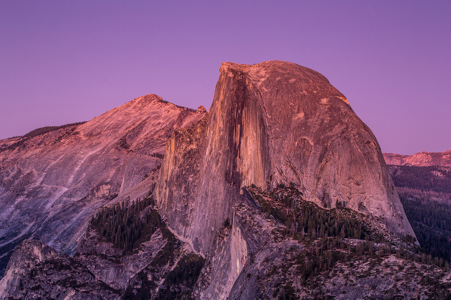 Half Dome is viewed from Glacier Point at sunset on October 5, 2019, in Yosemite National Park, California
