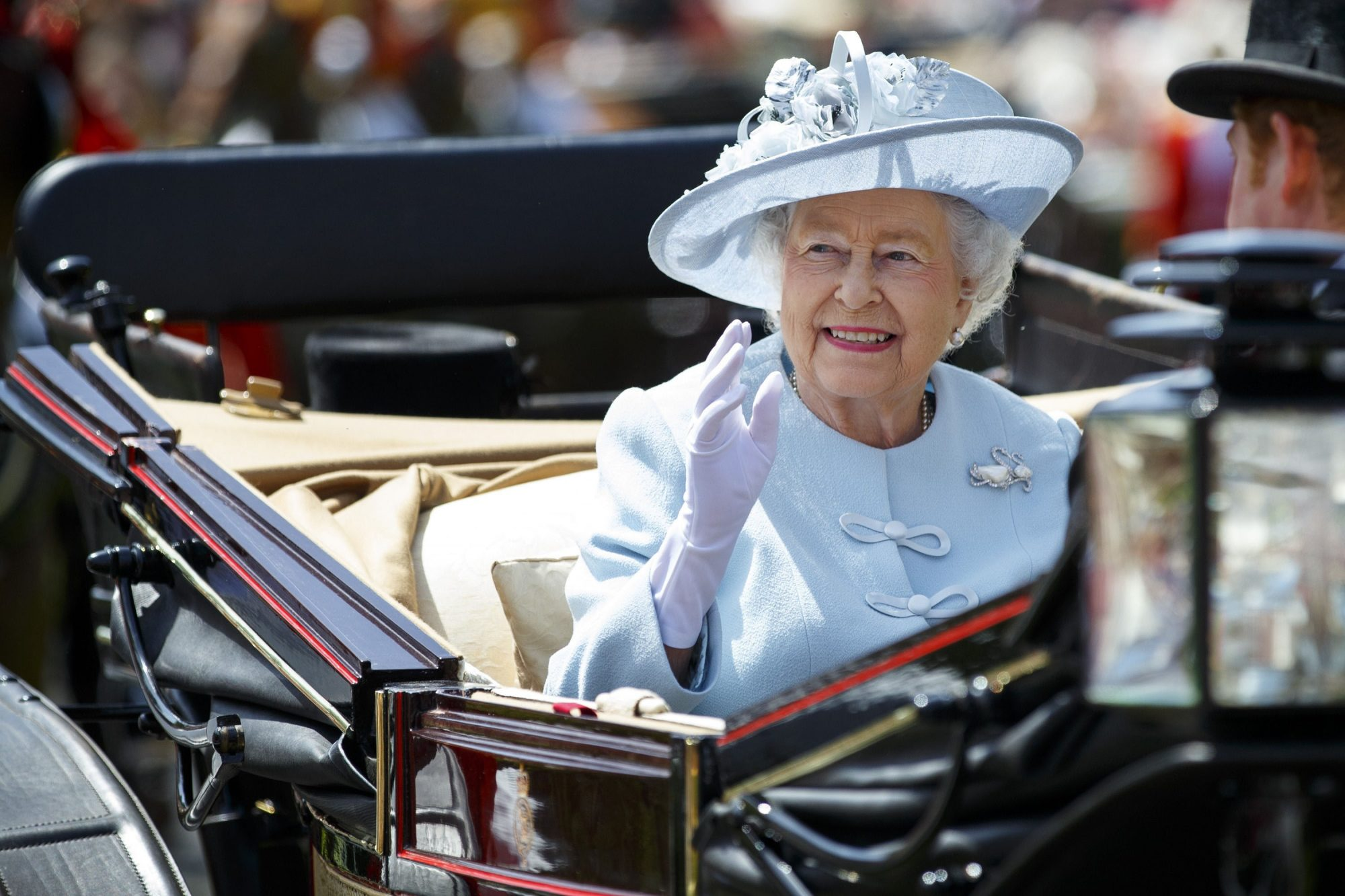 Queen Elizabeth riding in a Coach Trolley
