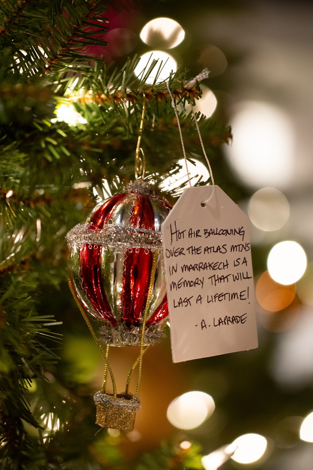 christmas ornament next to memory written on tree