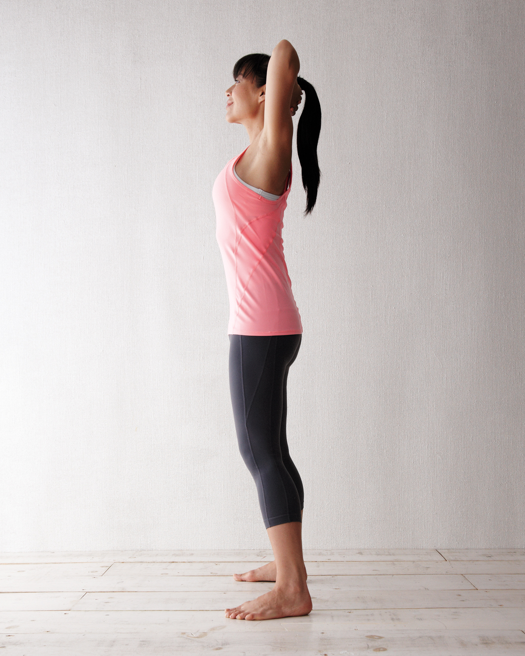 woman doing standing backbend exercise