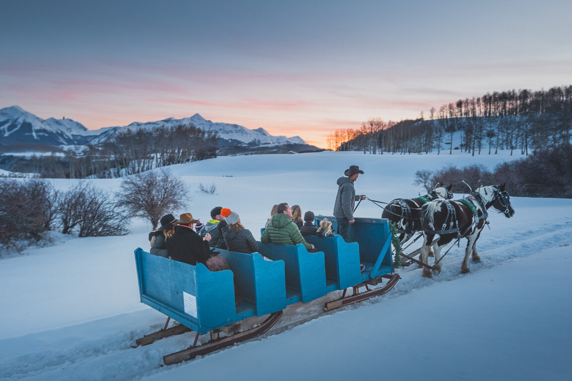 sleigh ride with sunset backdrop
