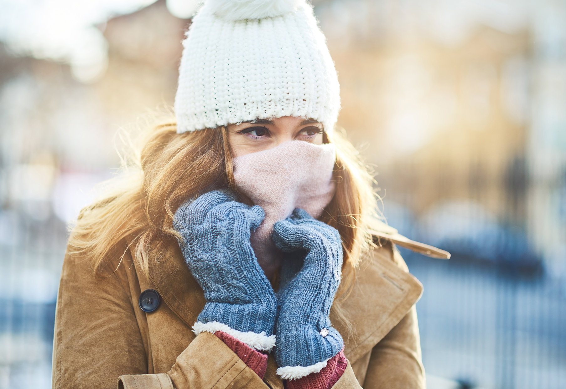 woman with scarf over her face in the cold