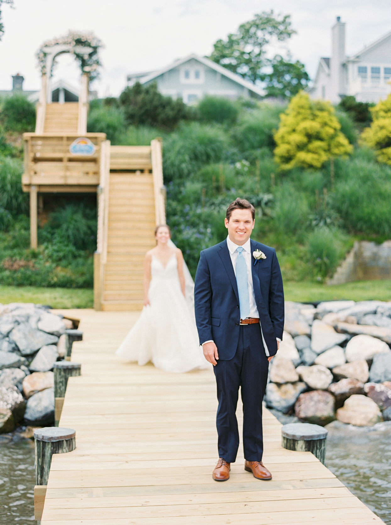bride and groom before first look on water pier outside