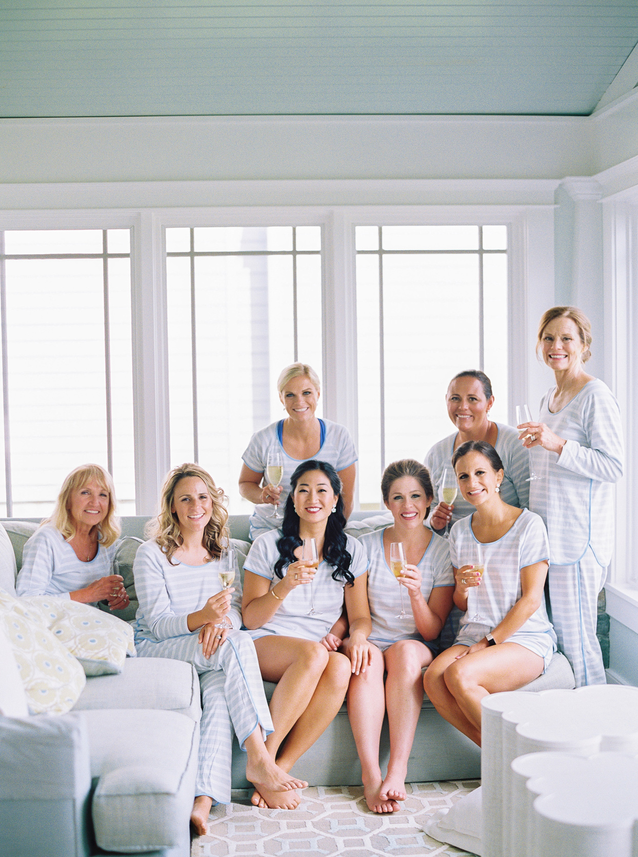 bride's bridal party wearing striped patterned pj sets