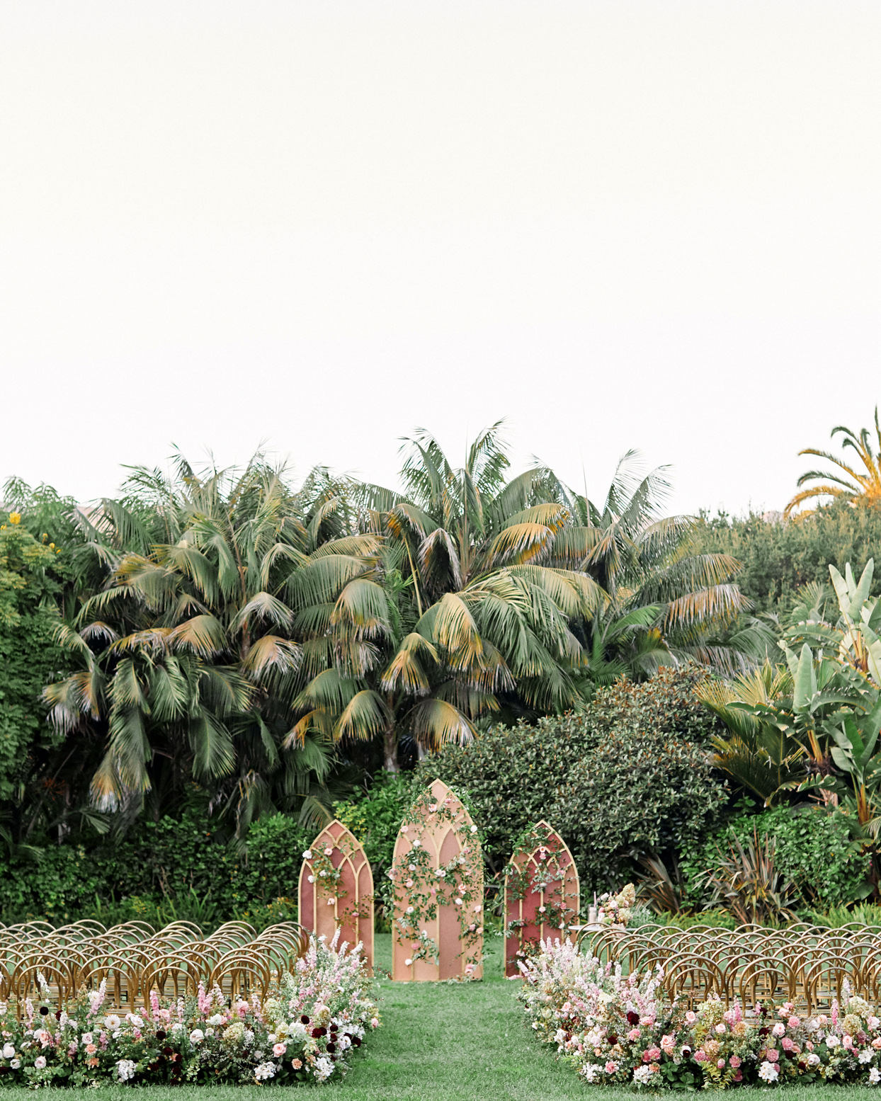 outdoor floral filled blush toned wedding ceremony set up