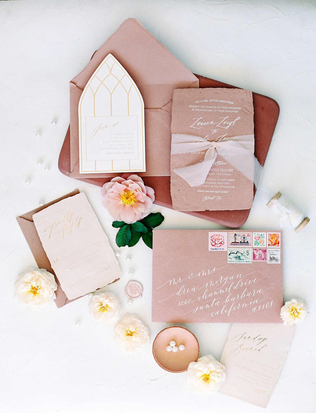 blush toned with white writing wedding invites