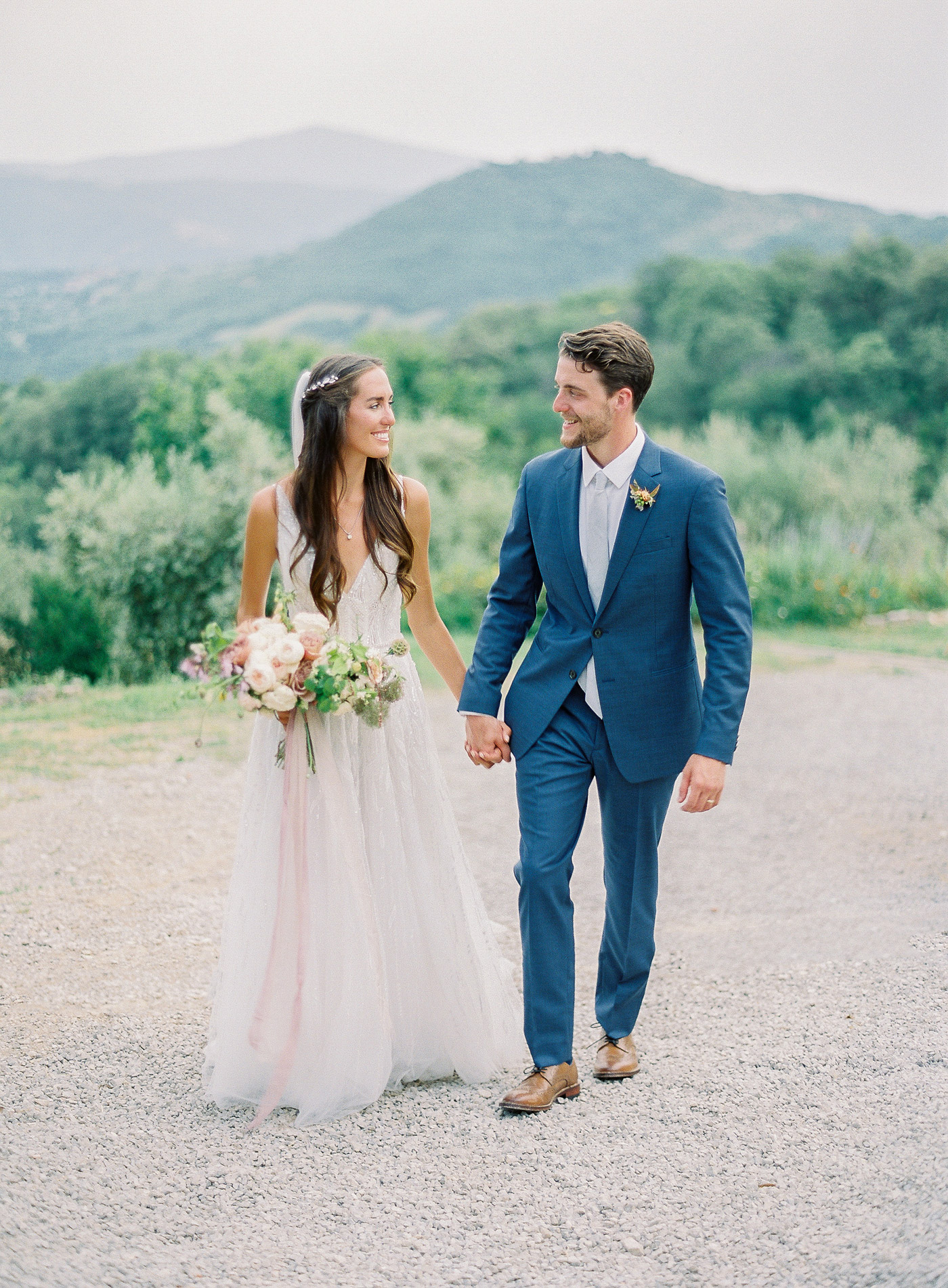 outdoor portrait wedding couple holding hands