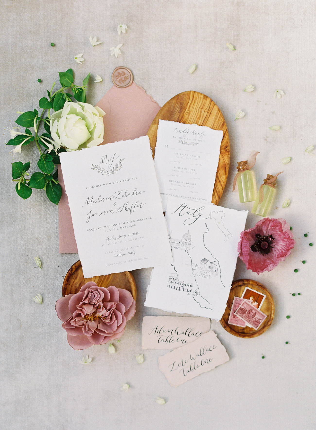wedding invites among bubbles stamps flowers
