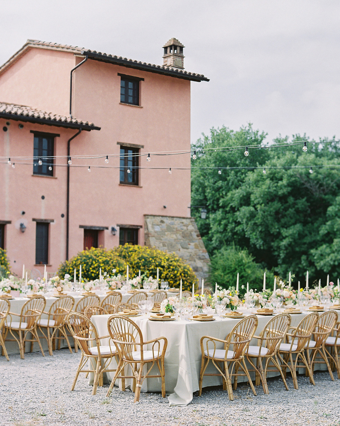 outdoor reception tables with floral and candle centerpieces