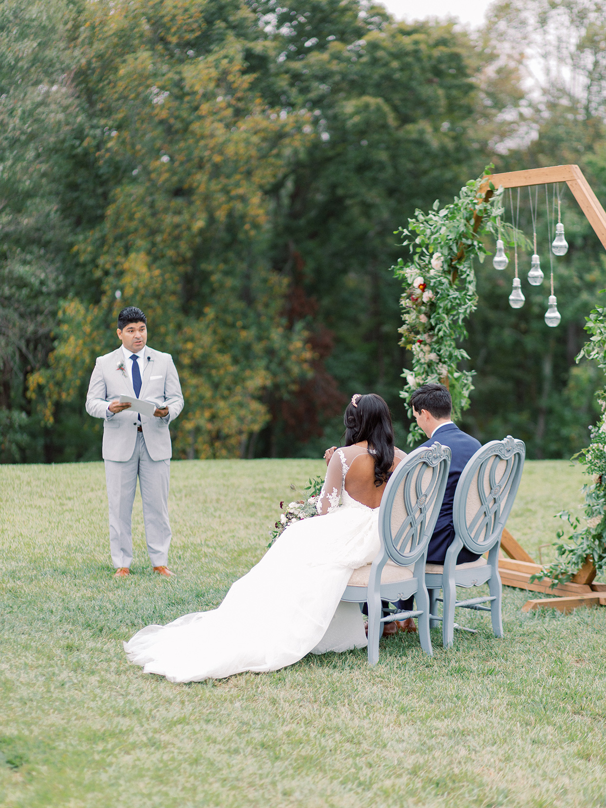 rebecca isaac wedding ceremony sitting in chairs
