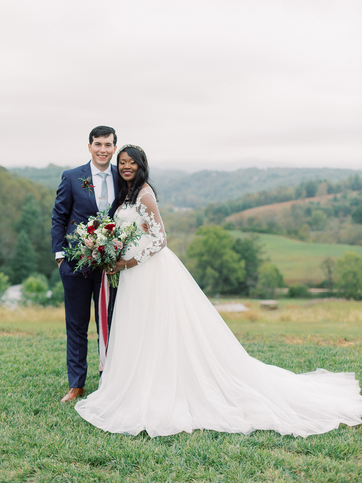 rebecca isaac wedding couple on grassy hill