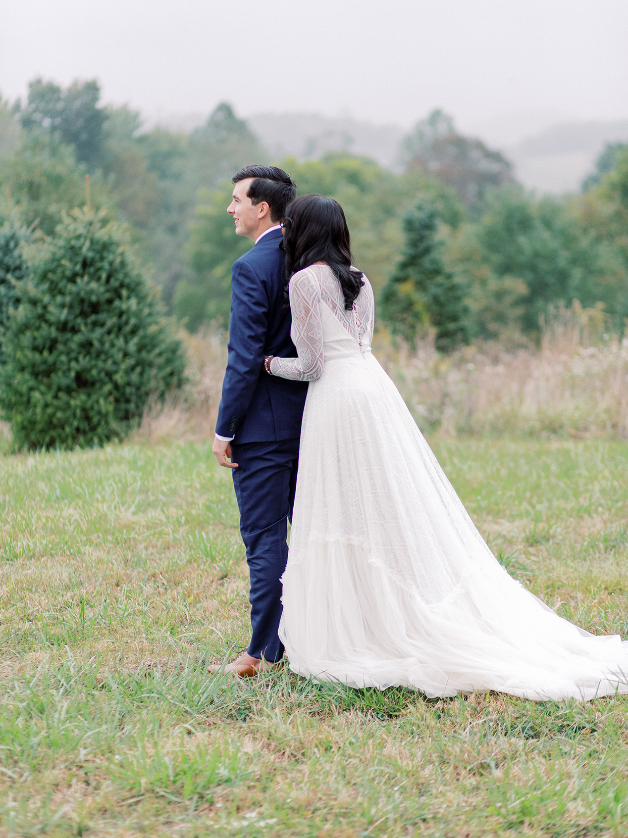 rebecca isaac wedding couple first look on grassy hill