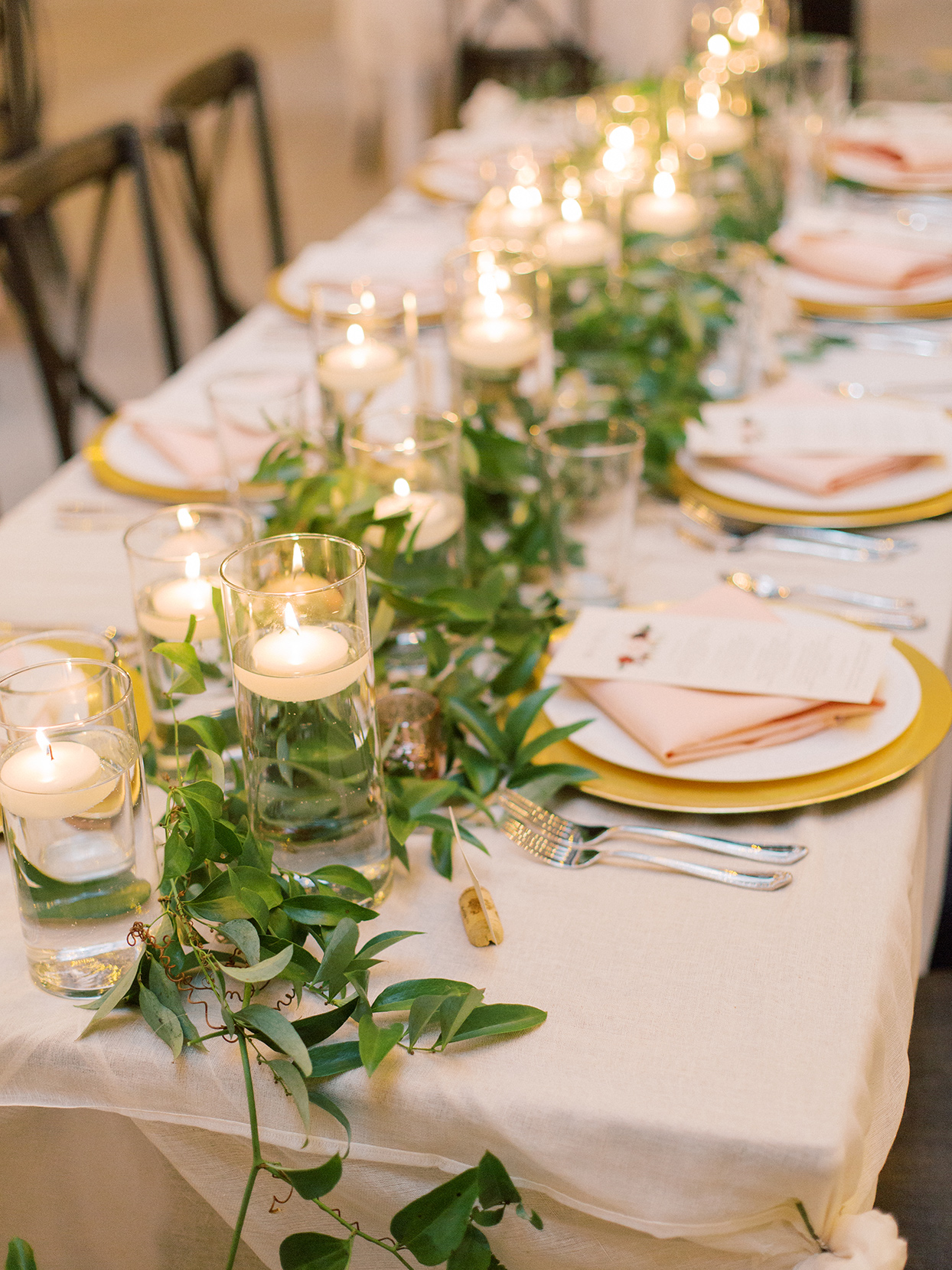 rebecca isaac wedding reception long table with candles and greenery