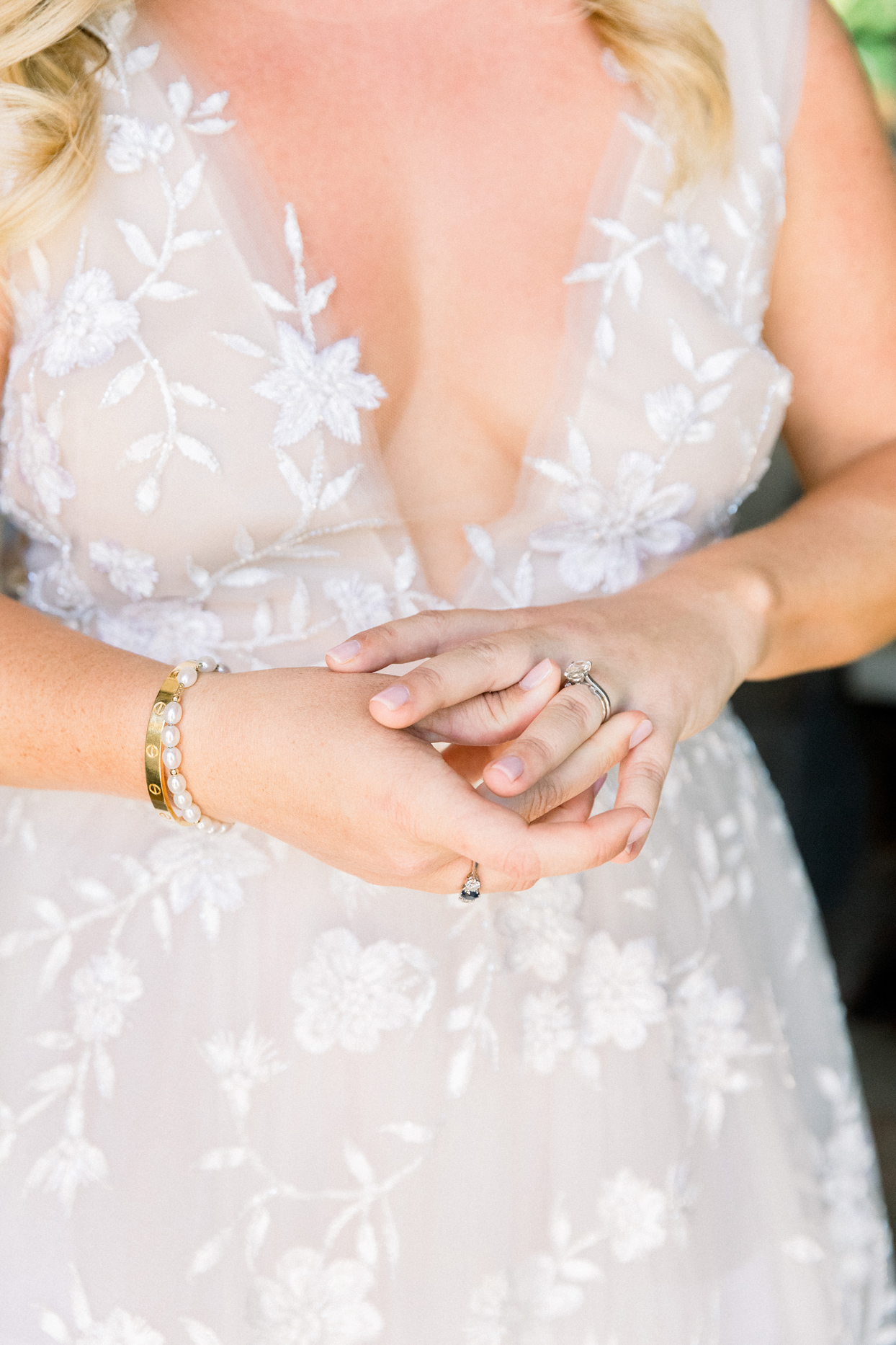 bride wearing rings and bracelets for bridal accessories