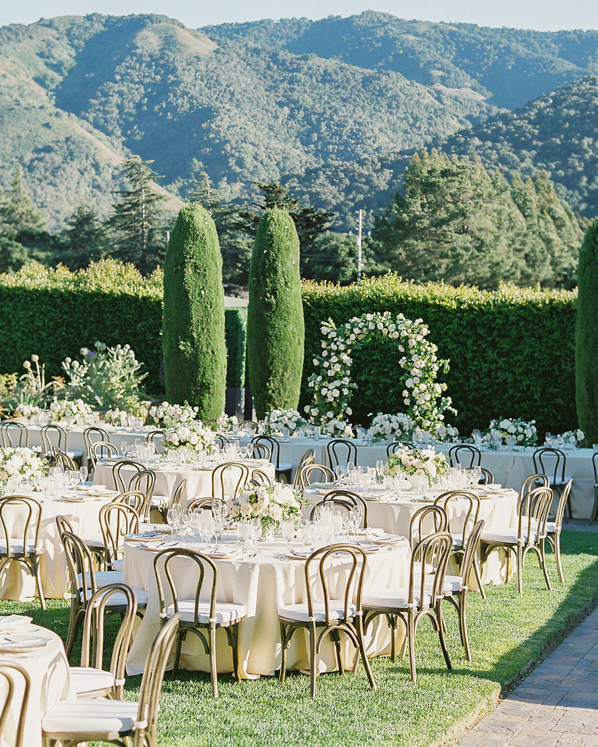 outdoor reception tables with cream colored linens