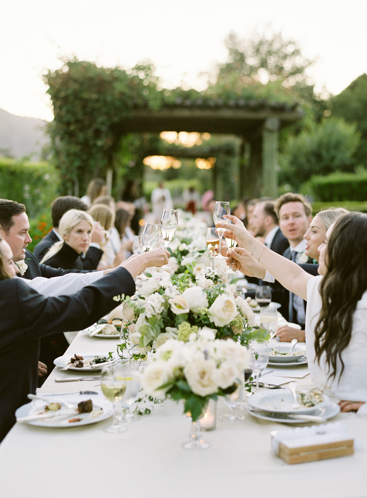 guests share wedding toast at reception table