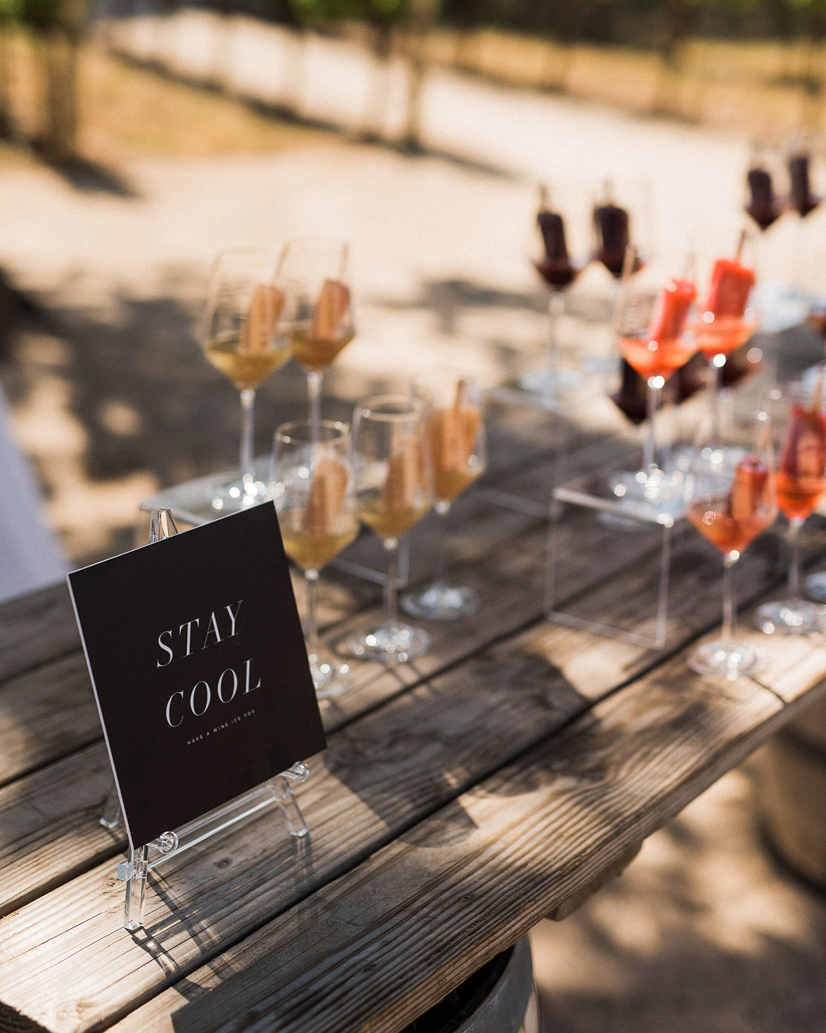 stay cool wedding sign on cocktail table