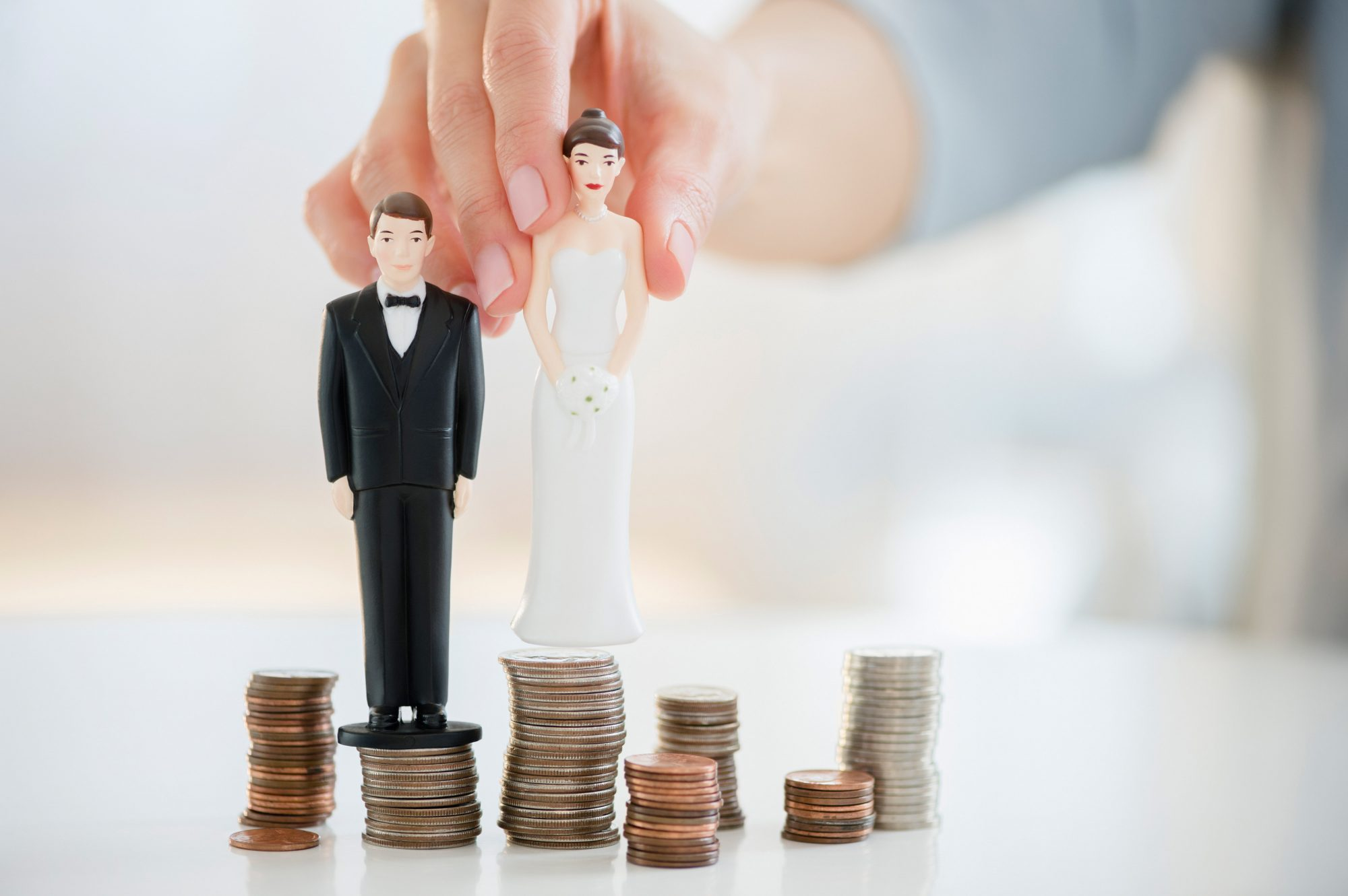 Wedding Budget, Bride and Groom Figurines on Money