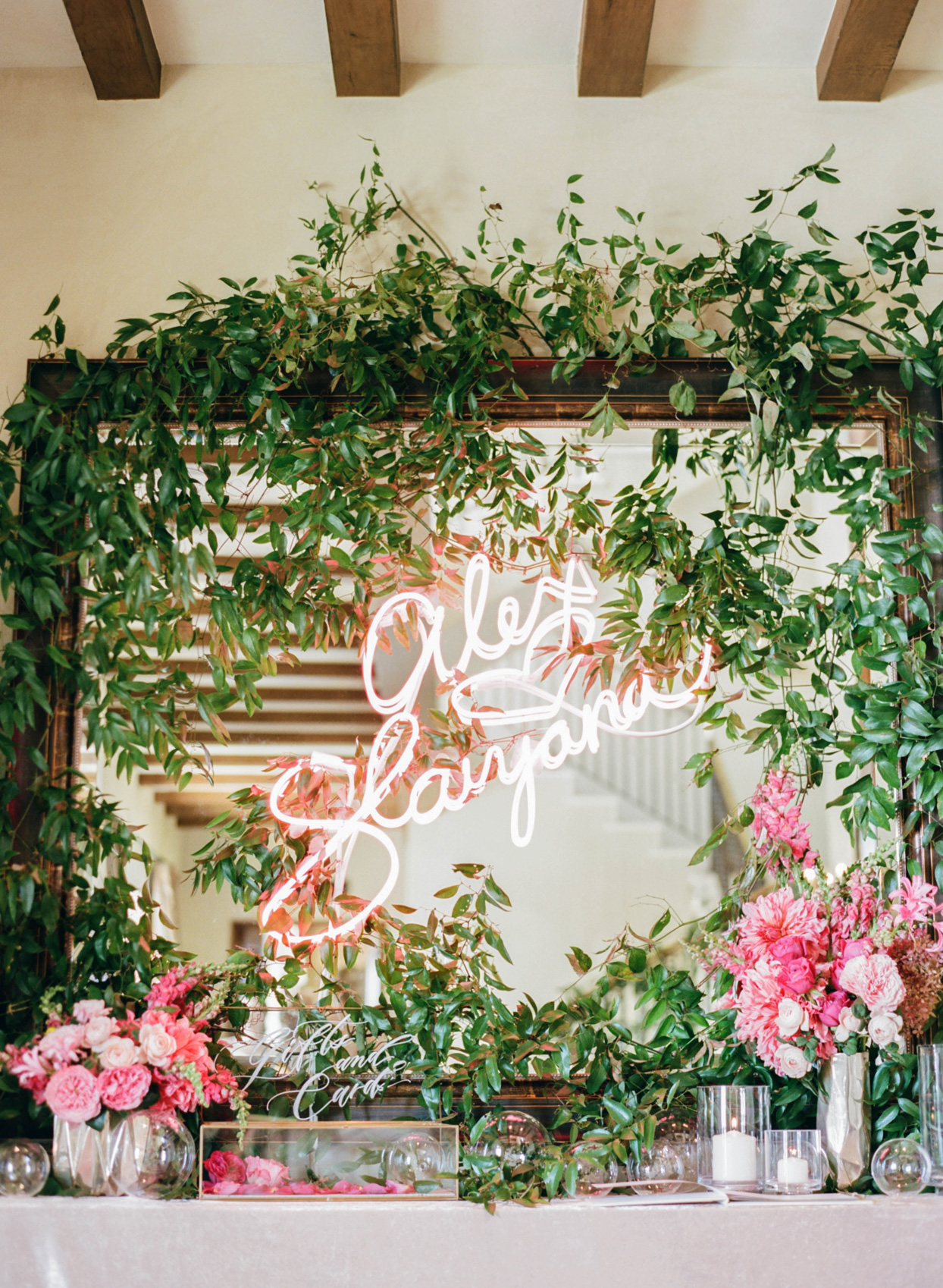 neon sign displaying bride and grooms names