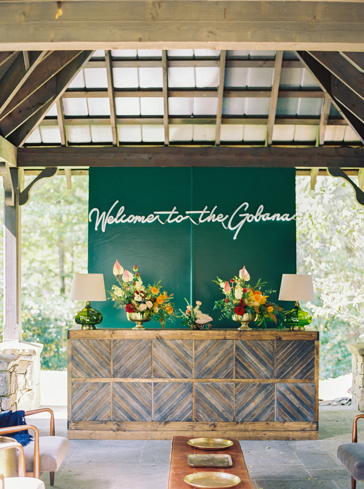 """Bar at wedding with sign that reads """"Welcome to the Gobana"""""""
