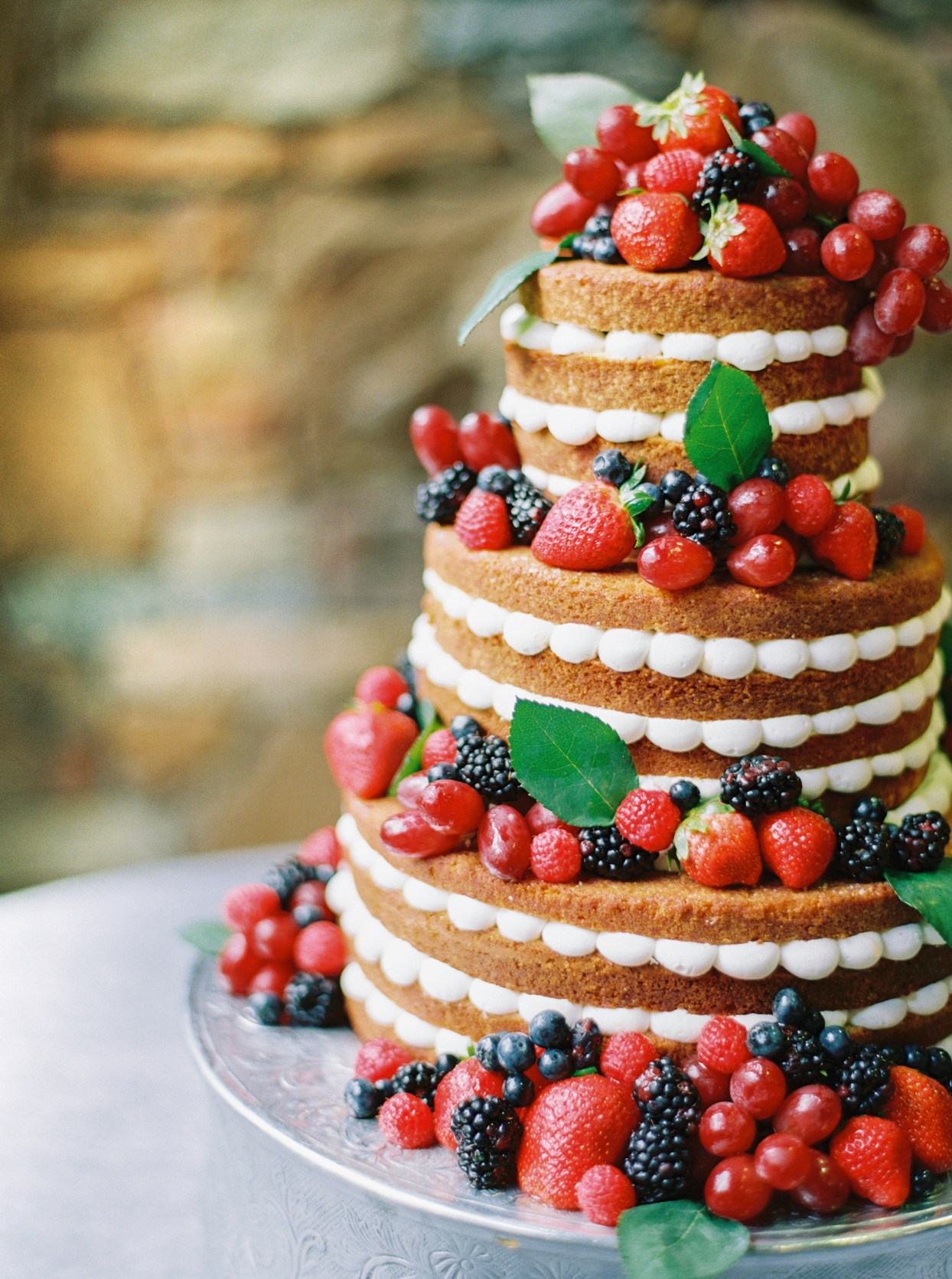 A millefoglie dessert with puff pastry, whipped cream, and fresh berries