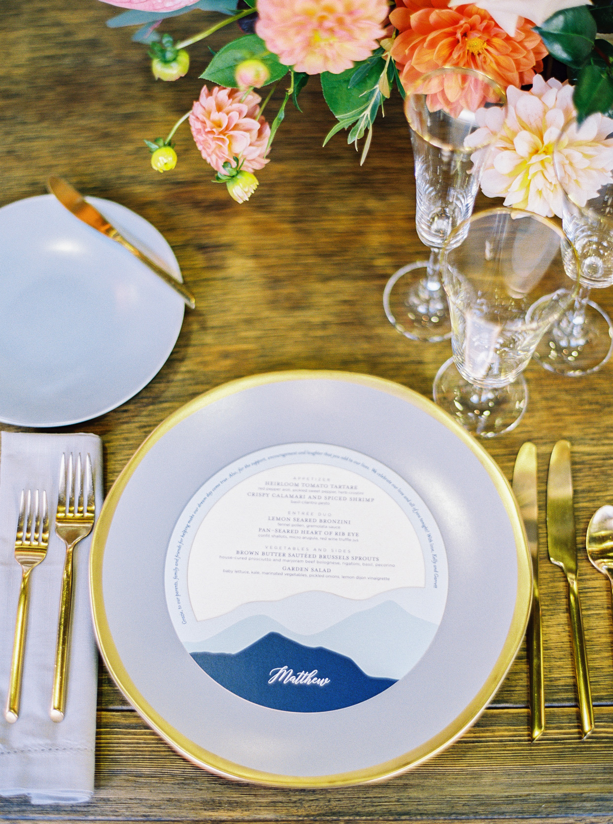 Round menu on gold rimmed charger plate
