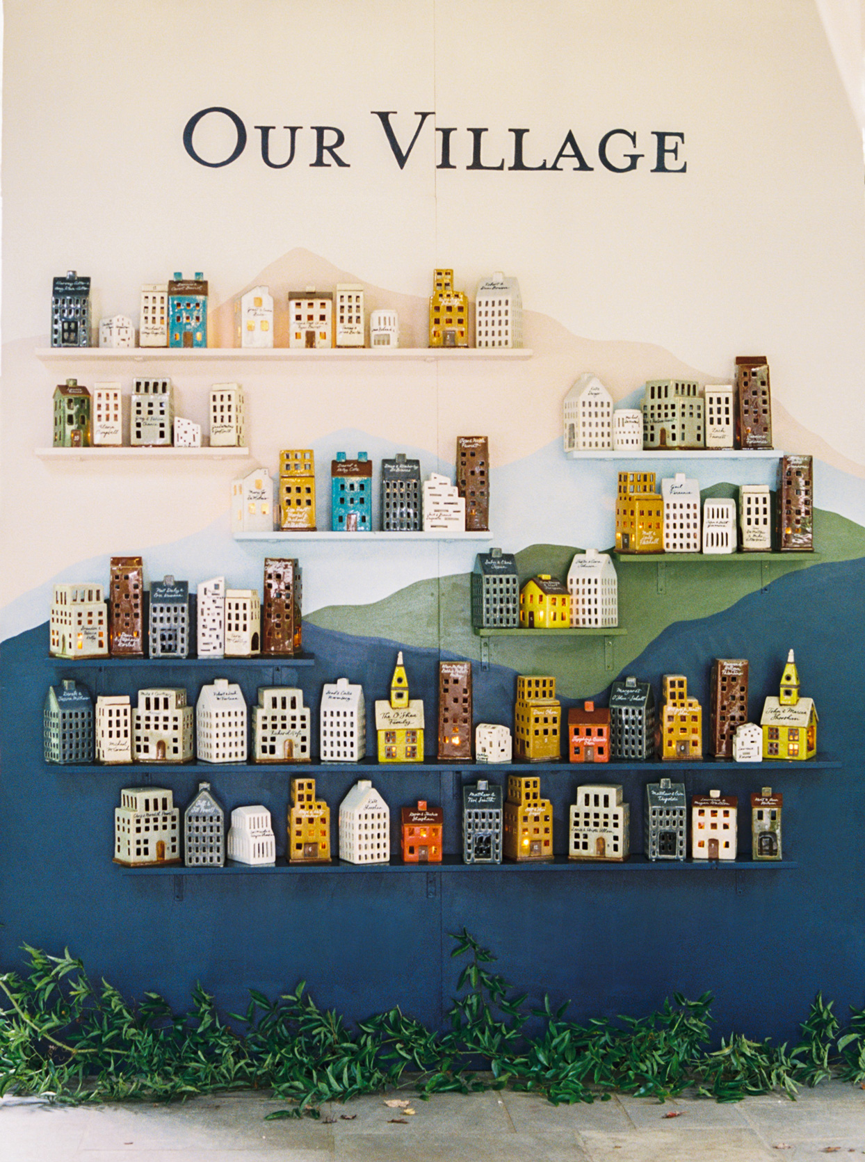 Wall of ceramic houses for guests to take home
