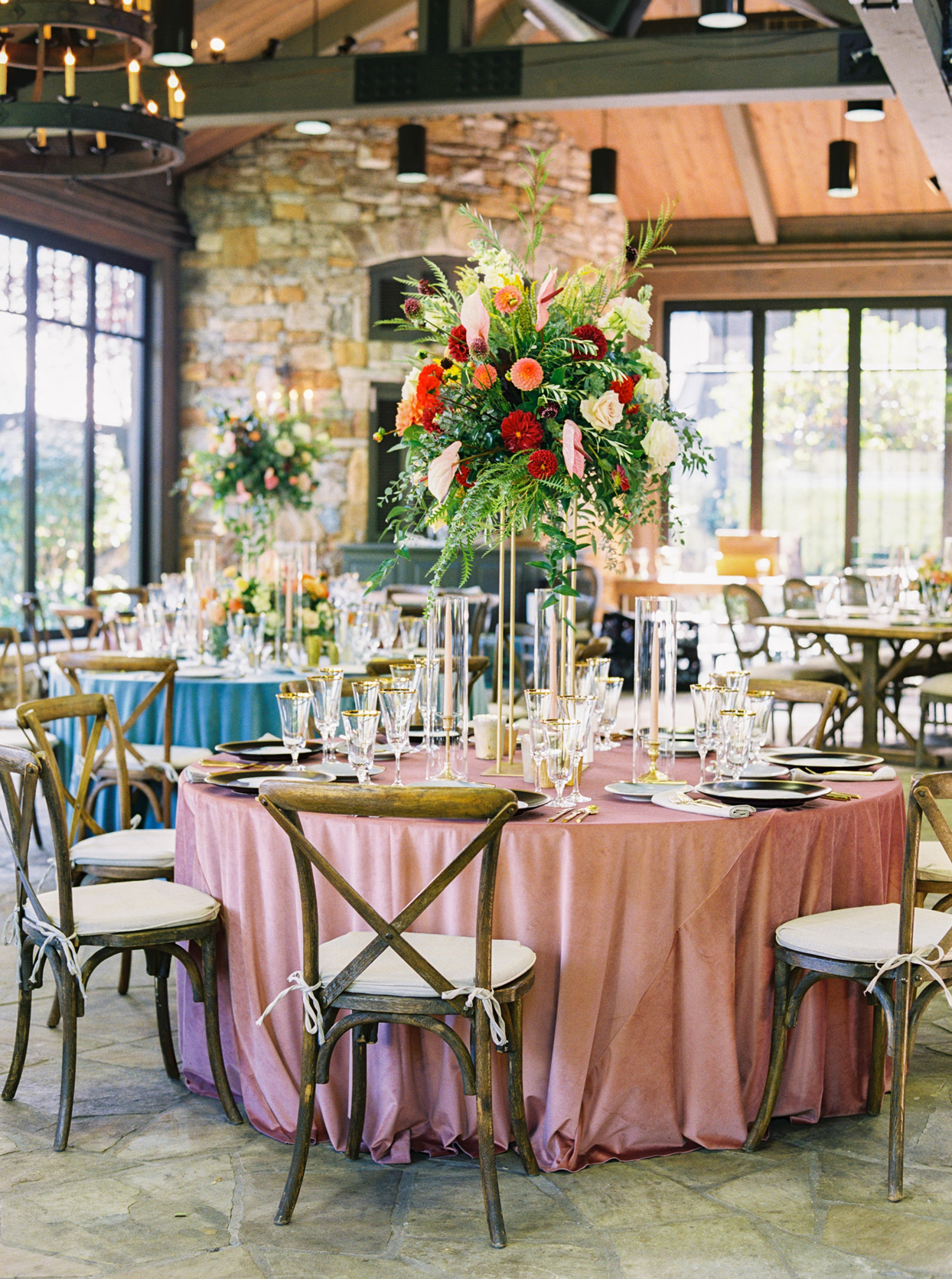 Round wedding tables with pink and blue table cloths