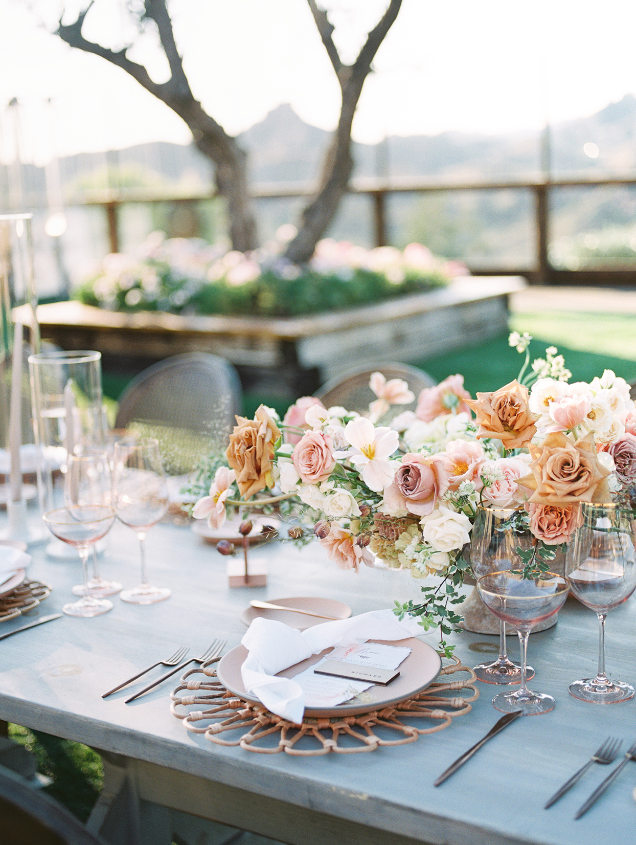 Wedding tabletop with blush and cream tones and dried flowers