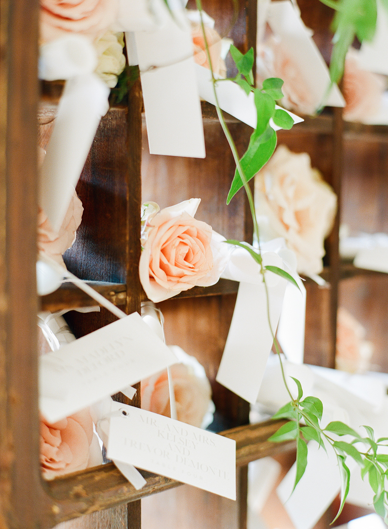 shelby david wedding escort card with peach colored roses