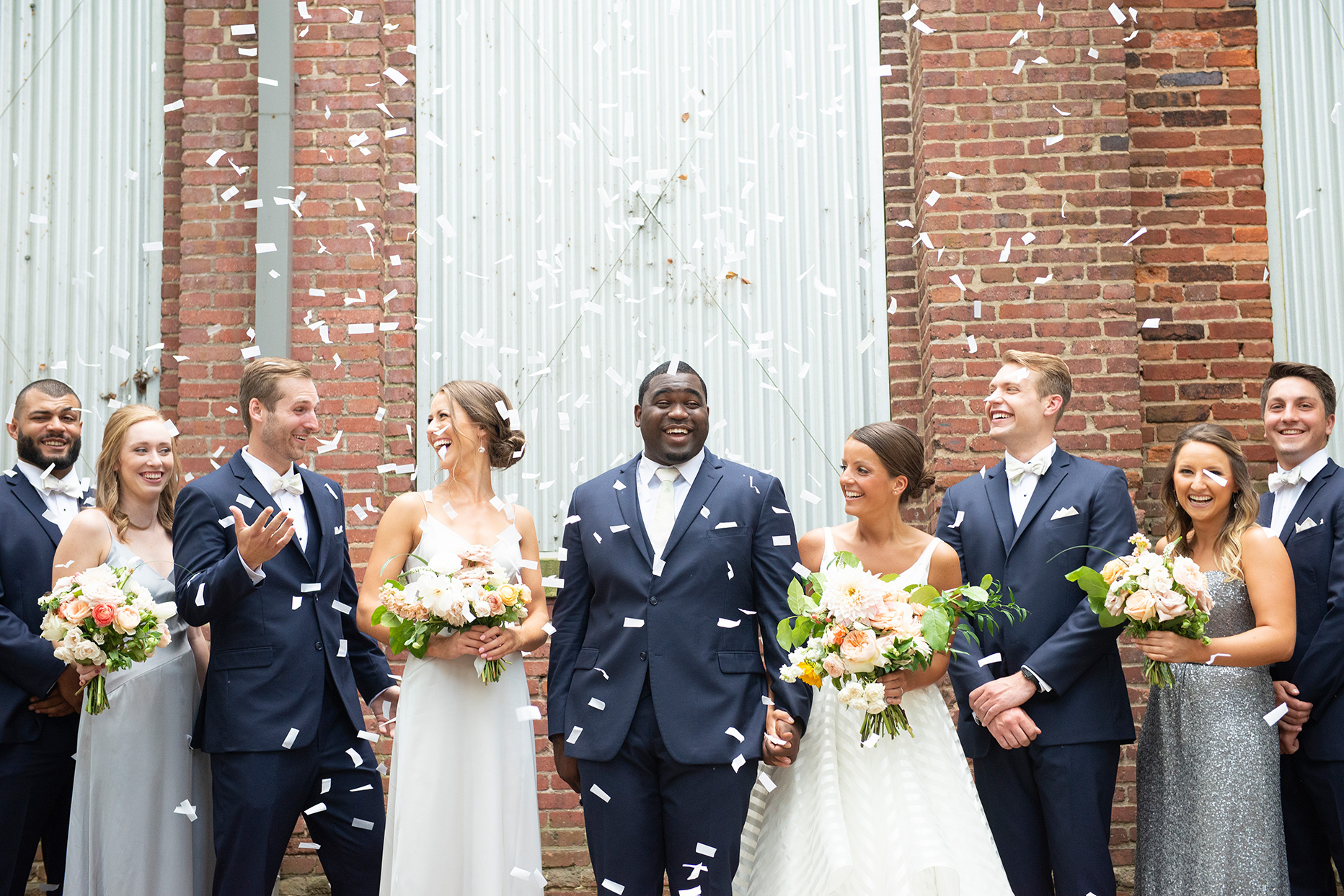 shelby david wedding party with white confetti