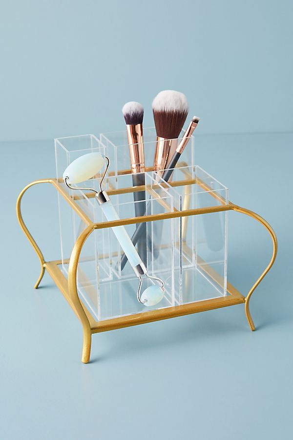 gold and acrylic cosmetics holder