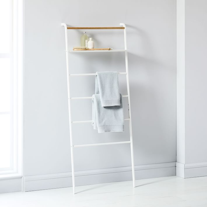 leaning white ladder organizer