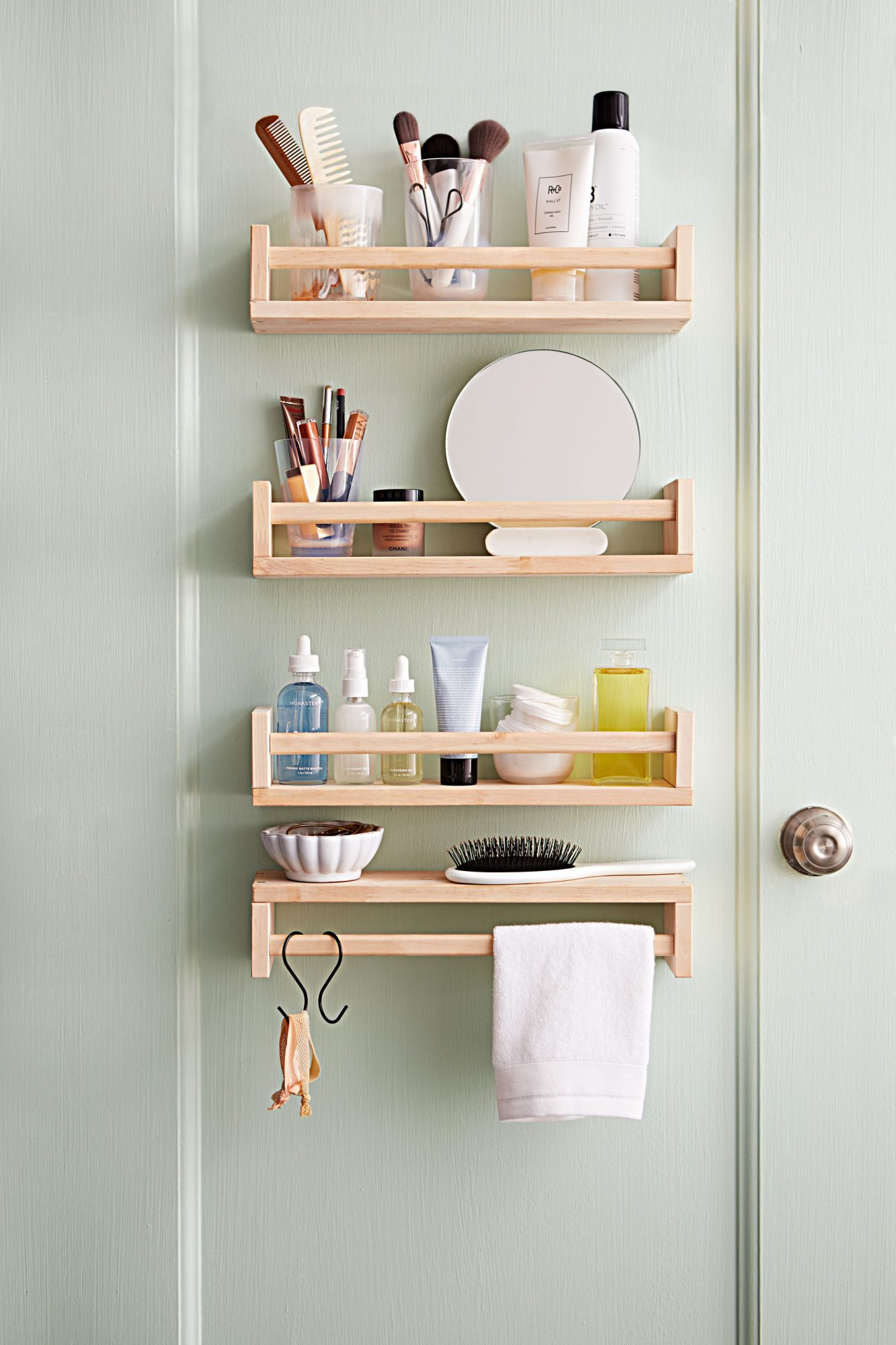 Take a rustic approach to stacked shelving by repurposing spice racks. You can also create extra space by flipping one upside-down for a bonus towel rack.  Shop Now: IKEA Wood Spice Rack, $49.99, amazon.com.