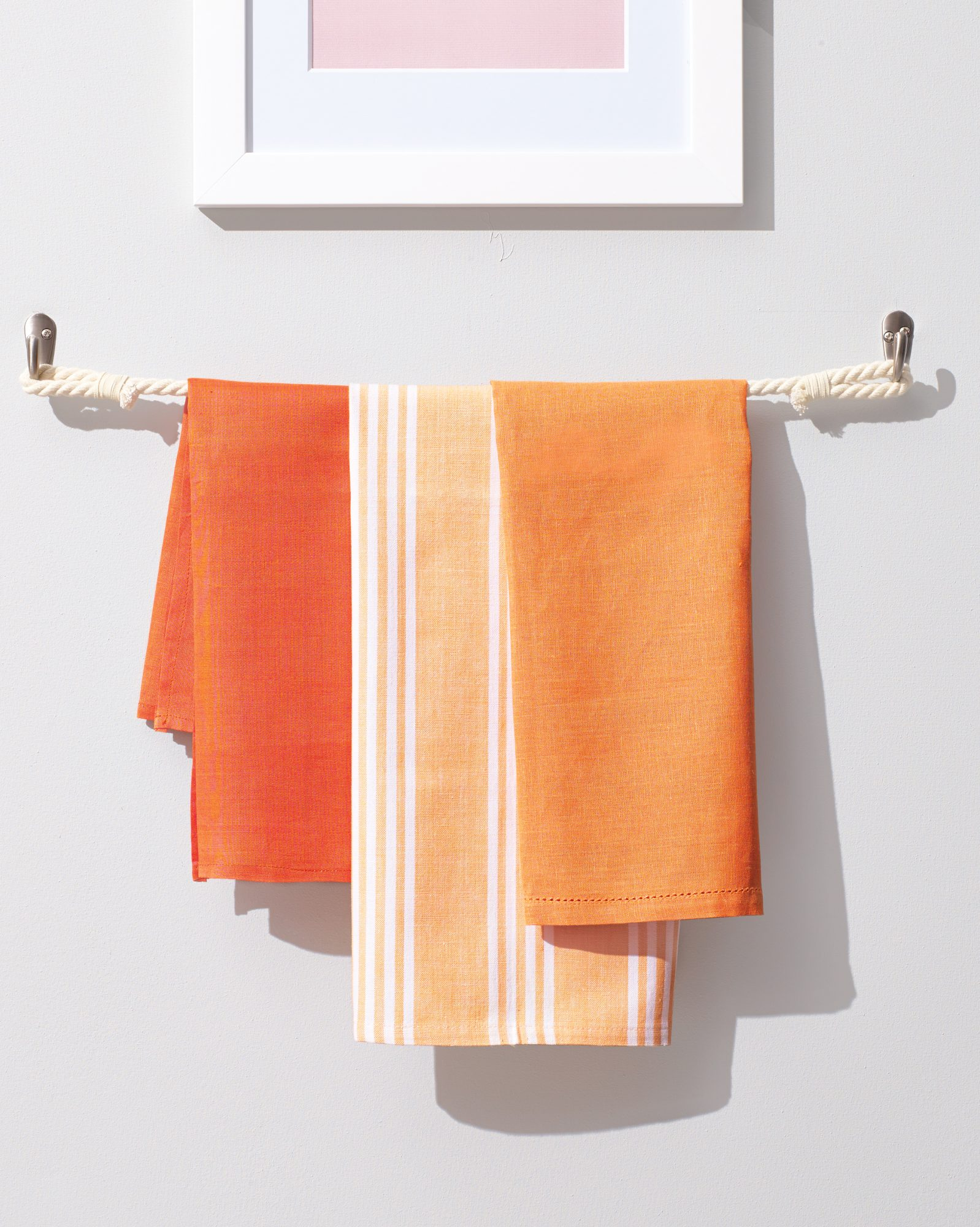 rope towel bar with orange towels