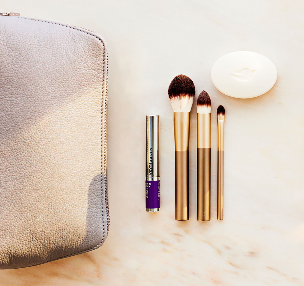 makeup bag next to beauty products