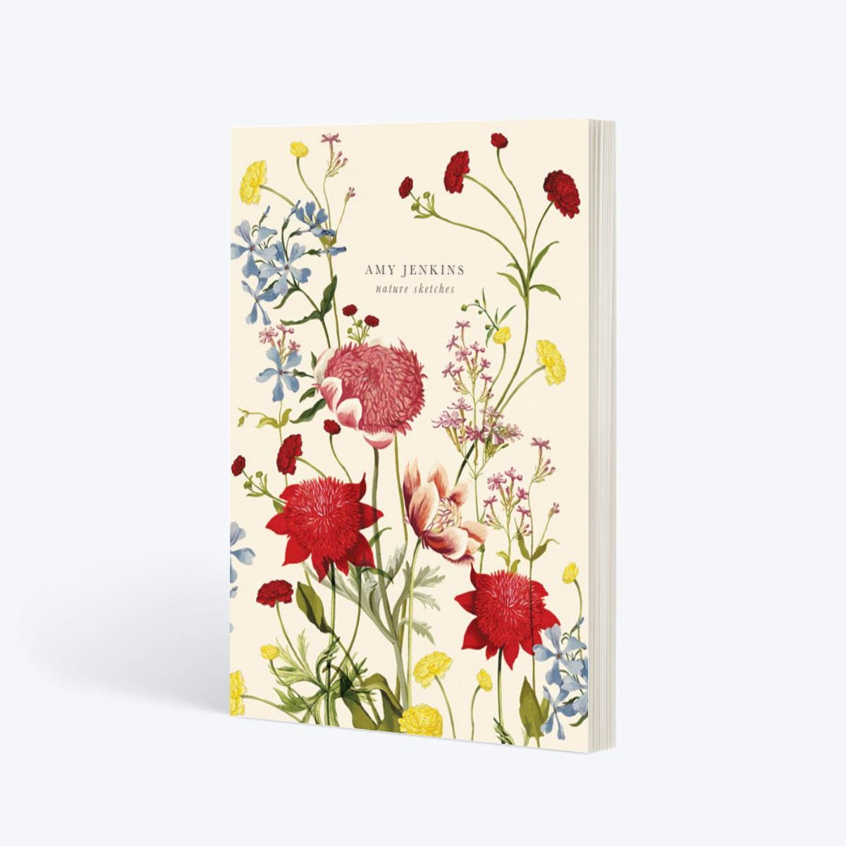 notebook with floral motif on cover