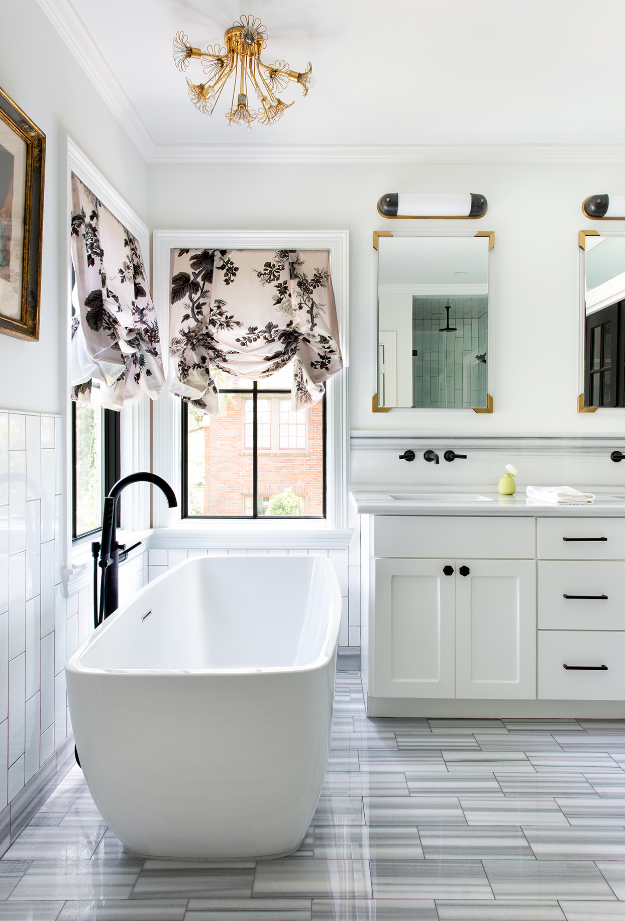white master bath with black accents and gray tile