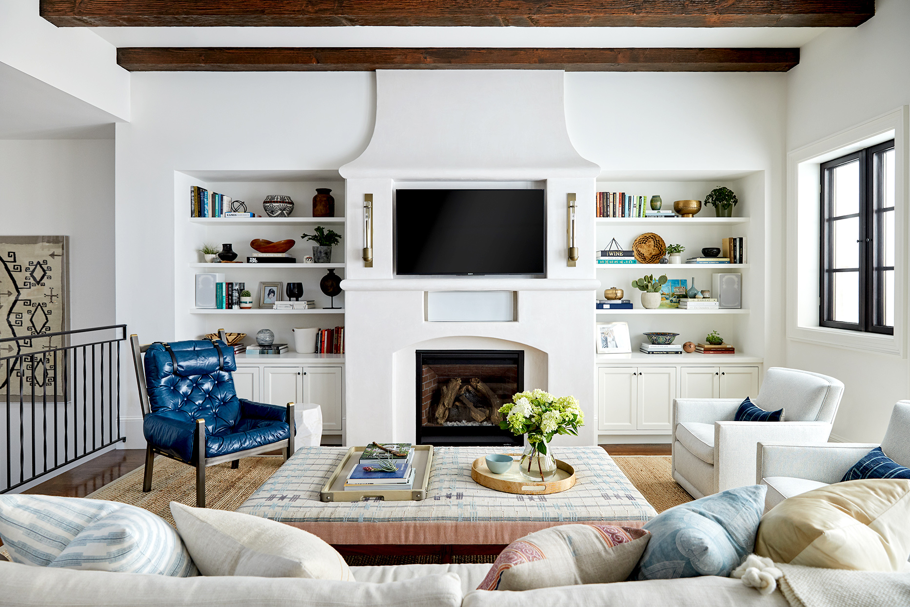 Living room with fireplace, couch and chair seating