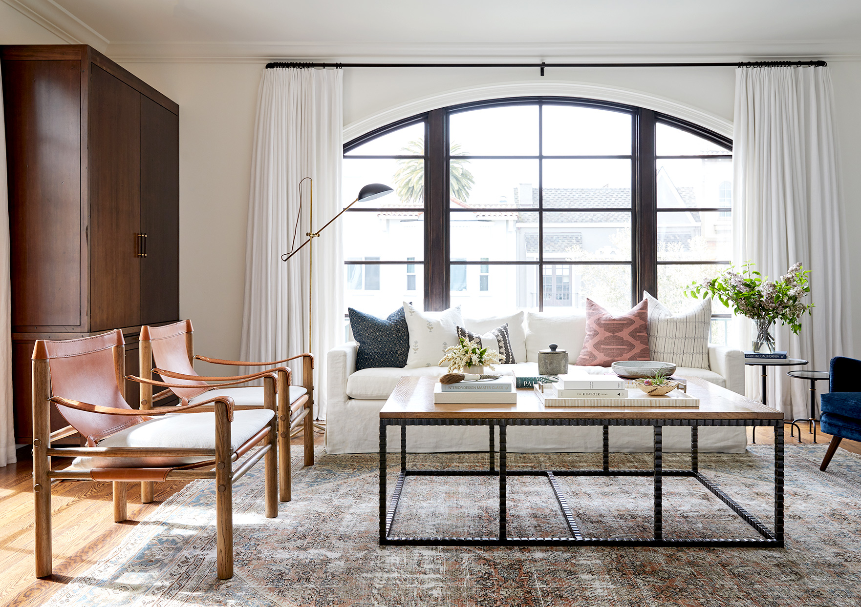 Living room with metal coffee table, couch, and chairs