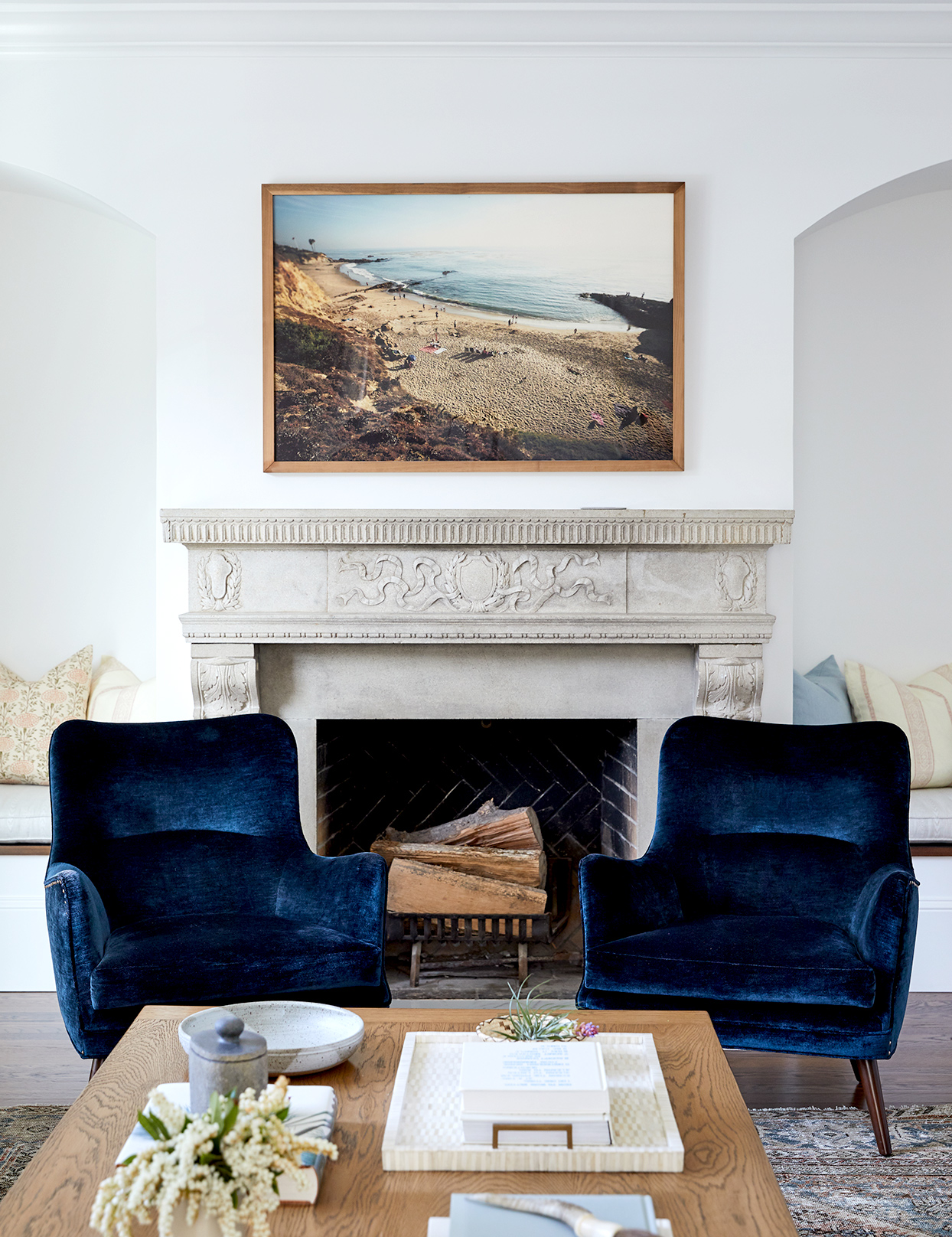 Fireplace with dark blue chairs